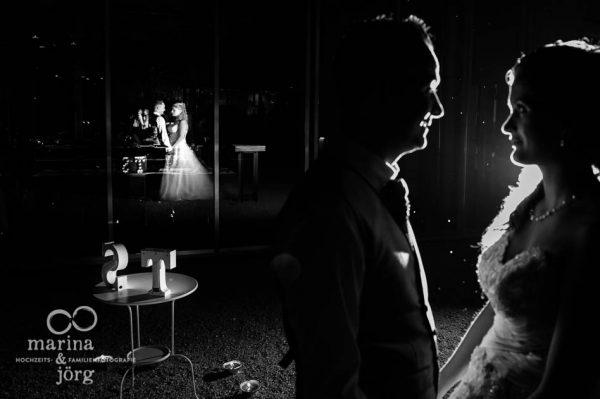 Hochzeitsfotografen-Paar Marina und Joerg aus Giessen: ganztaegige Hochzeitsreportage in der Naehe von Bern (Kirche Ligerz und amboz Werk- und Eventhalle)